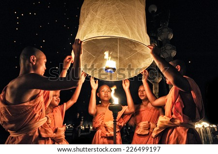 CHIANG MAI THAILAND - OCTOBER 25 : The Floating Lanterns Tudong - Khasathan festival. Novices lights floating lanterns made of paper annually at the Sansai. on Oct. 25, 2014 in Chiang Mai, Thailand. - stock photo