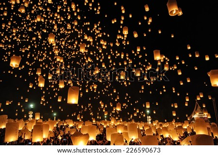 CHIANG MAI THAILAND - OCTOBER 25 : The Floating Lanterns Tudong - Khasathan festival. Tourist lights floating lanterns made of paper annually at the Sansai. on Oct. 25, 2014 in Chiang Mai, Thailand. - stock photo