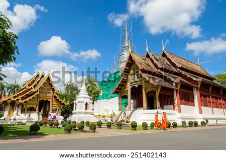 CHIANG MAI, THAILAND - OCTOBER 25, 2014 :Wat Phra Singh Woramahaviharn is the  famous Buddhist temple in the old city centre of Chiang Mai. The main entrance is guarded by lion (Singha). - stock photo