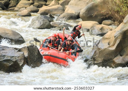 CHIANG MAI, THAILAND - OCTOBER 20 : White water rafting on the rapids of river Maetang on OCTOBER 20, 2014 in Chiang Mai, Thailand.  Maetang river is one of the most dangerous rivers of Thailand. - stock photo