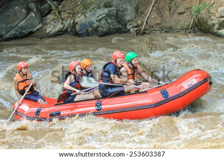 CHIANG MAI, THAILAND - OCTOBER 24 : White water rafting on the rapids of river Maetang on OCTOBER 24, 2014 in Chiang Mai, Thailand.  Maetang river is one of the most dangerous rivers of Thailand. - stock photo
