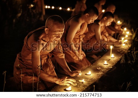 CHIANG MAI, THAILAND - SEP 5: Unidentified monk in Thai Traditional Loy Krathong festival at Wat Umong, September, 2014 in Chiang mai, Thailand. - stock photo