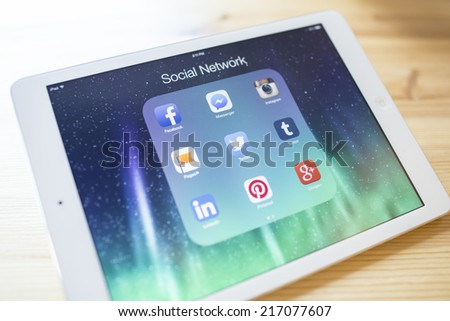CHIANG MAI, THAILAND - SEPTEMBER 07, 2014: All of popular social media icons on Apple new iPad Air device screen wood background. - stock photo