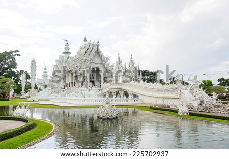 CHIANG RAI AUG 11: Beautiful white church of Wat Rong Khun temple in Chiangrai, Thailand on August 11th, 2014. The temple is one of the most tourist attraction place in the northern of Thailand. - stock photo