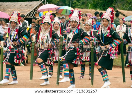 CHIANG RAI,THAILAND-AUGUST 30,2015: The Akha Hill tribe minority traditional dancing on Swing Festival is enjoy music and dance and have a go on the giant swing  on mountain in Northern of Thailand. - stock photo