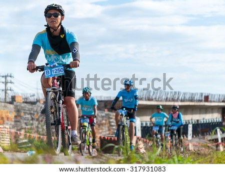 "CHIANG RAI,THAILAND-AUGUST 16-2015: This event is ""Bike for mom"" from Thailand. Bike for mom event show respected to Queen and makes Thailand's cyclists set record for world's biggest bike ride. - stock photo"