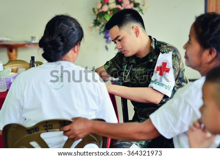 CHIANG RAI, THAILAND JUNE 6 2015: Unidentified military doctors from public hospital are in medical services at Ban Sop Kok city of Chiang Saen in Chiang rai,Thailand. - stock photo