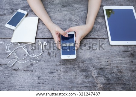CHIANG RAI, THAILAND - SEPTEMBER 13, 2015: Woman try to log in page Facebook application using Apple iPhone 6. Facebook is largest and most popular social networking site in the world. - stock photo