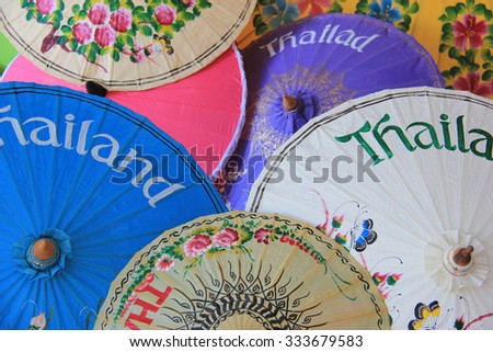 Chiangmai classic umbrellas are famous handmade traditional products of Thailand. - stock photo