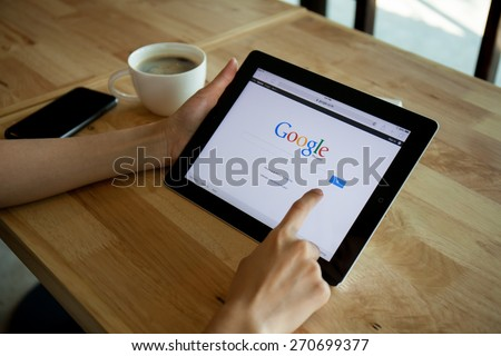 CHIANGMAI,THAILAND - APRIL 19, 2015: Photo of ipad device with a Google search app running - stock photo