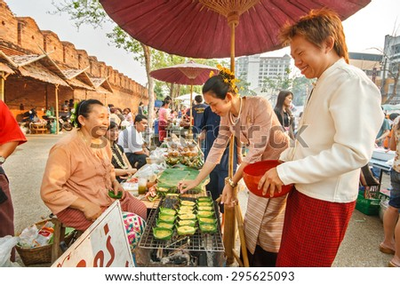CHIANGMAI, THAILAND - APRIL 13: The simulate retro market of Lanna in the past in Songkran Festival on April 13, 2008 in Chiang Mai, Thailand. - stock photo
