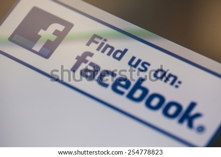 CHIANGMAI,THAILAND - FEBRUARY 22: Facebook logo on Apple iPad. Facebook is largest and most popular social networking site in the world. - stock photo