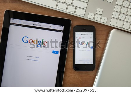 Chiangmai,Thailand - February 10, 2015:  Google search page on screen of ipad and Iphone. In December 2013 Alexa listed google.com as the most visited website in the world - stock photo