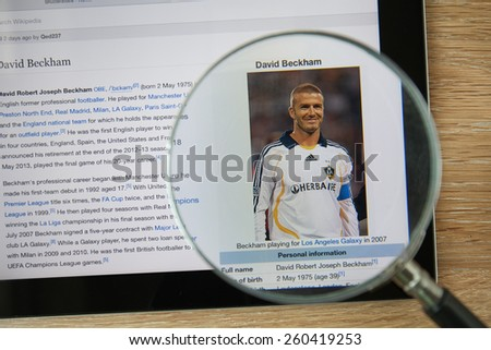 CHIANGMAI, THAILAND - February 26, 2015: Photo of Wikipedia article page about David Beckham on a ipad monitor screen through a magnifying glass. - stock photo