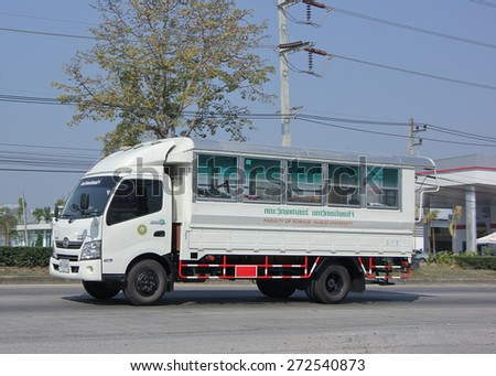 CHIANGMAI, THAILAND -JANUARY 30 2015:  School bus truck of Maejo University. Photo at road no.1001 about 8 km from city center, thailand. - stock photo