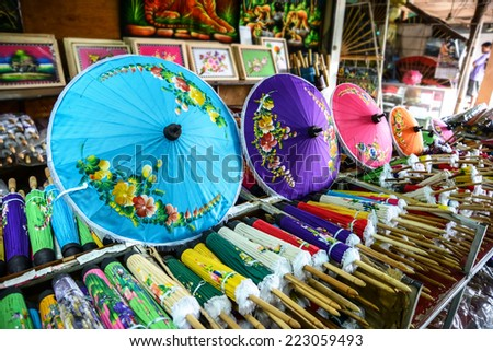 CHIANGMAI, THAILAND - JULY 28: Colorful handmade umbrella for sale on July 28, 2014  in the village Bo Sang, Chiang Mai, Thailand. Bo Sang is known for its handmade umbrellas and parasols. - stock photo
