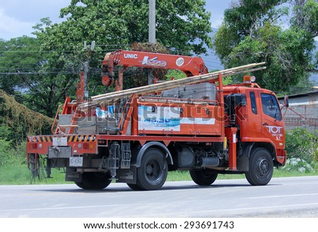 CHIANGMAI, THAILAND -JUNE 30 2015: Truck with crane of Tot company.Intenet and Telephone Service in Thailand.  Photo at road no.1001 about 8 km from downtown Chiangmai, thailand. - stock photo