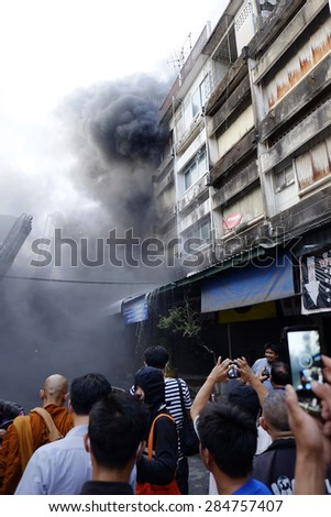 CHIANGMAI THAILAND - JUNE 5 : Warorot market fire. Fire the old market of the city. The latest fire was burning fabric store damaged several shops. on June 5 , 2015 in Chiang Mai,Thailand. - stock photo
