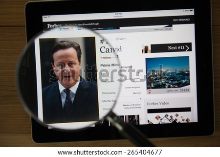 CHIANGMAI, THAILAND - March 31, 2015: Photo of Forbes article page about David Cameronon a ipad monitor screen through a magnifying glass. - stock photo