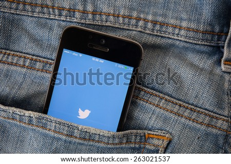 "CHIANGMAI, THAILAND - MARCH 23, 2015: Twitter is an online social networking and microblogging service that enables users to send and read ""tweets"", limited to 140 characters. - stock photo"