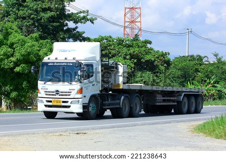 Chiangmai, Thailand - October 3, 2014: Trailer Truck of Tangheng Service transport company. Photo at road no.121 about 8 km from downtown Chiangmai, thailand. - stock photo