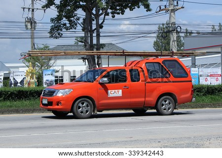 CHIANGMAI, THAILAND -SEPTEMBER  22 2015:   Pickup truck of CAT Telecom Public Company Limited.  Photo at road no 121 about 8 km from downtown Chiangmai, thailand. - stock photo