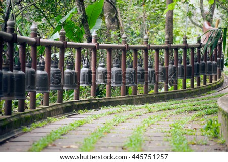 CHIANGRAI,THAILAND-AUGUST 31,2015 :Bells on footpath on  Wat Phra That Doi Tung. this temple has a stupa reputed to contain the Buddha's collarbone, Located Chiangrai Province in Northern of Thailand. - stock photo