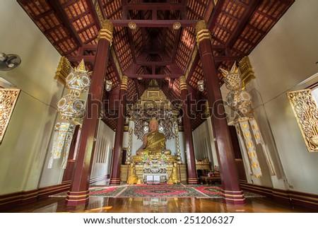 CHIANGRAI ,THAILAND - DECEMBER 16,2014 : The Golden seated presiding Buddha in Phra That Chom Kitti temple, Chiang Saen, Thailand, - stock photo