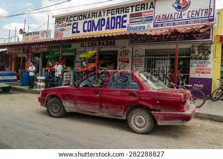 Chiapas, MEXICO - MARCH 18,2015: Old destroyed car on the street in Chiapas, Mexico. - stock photo