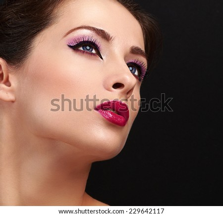 Chic woman face makeup. Long lashes and gloss lipstick. Closeup on black background - stock photo