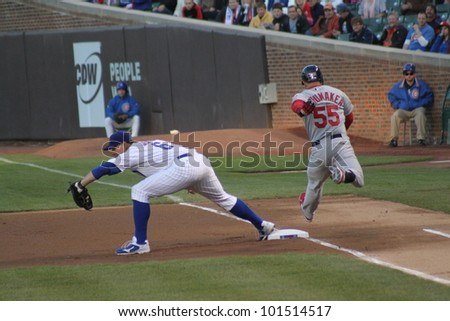 CHICAGO - APRIL 25: Carlos Beltran of the St. Louis Cardinals runs to first base against the Chicago Cubs at Wrigley Field on April 25, 2012 in Chicago, Illinois. - stock photo