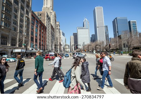 CHICAGO - April 10: Downtown Chicago on April 10, 2015 in Chicago, IL. Chicago  is the third most populous city in the United States, after New York City and Los Angeles.  - stock photo