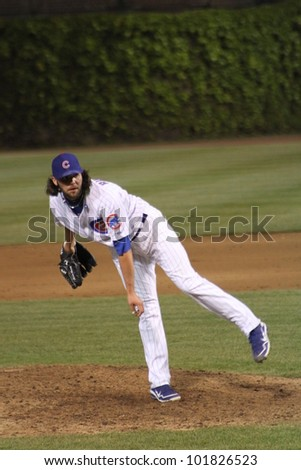 CHICAGO - APRIL 25: James Russell of the Chicago Cubs pitches against the St. Louis Cardinals at Wrigley Field on April 25, 2012 in Chicago, Illinois. - stock photo