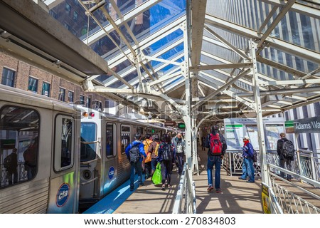 CHICAGO - April 10 : People riding Metra on April 10, 2015. Metra is the commuter rail division of the Regional Transportation Authority of the Chicago metropolitan area - stock photo