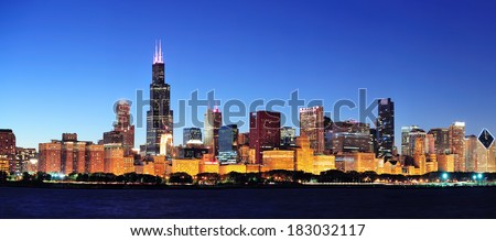 Chicago city downtown urban skyline panorama at dusk with skyscrapers over Lake Michigan with clear blue sky. - stock photo