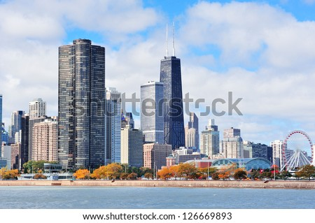Chicago city urban skyline with skyscrapers over Lake Michigan with cloudy blue sky. - stock photo