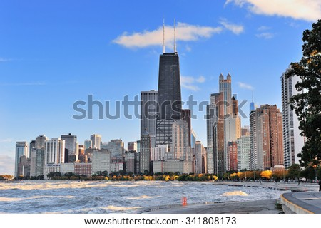 Chicago city urban skyscraper at downtown lakefront at sunset with Lake Michigan viewed from North Avenue Beach. - stock photo