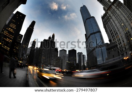 Chicago downtown buildings at night on street with traffic - stock photo