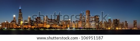 Chicago downtown city skyline at night and Michigan lake shore drive - stock photo