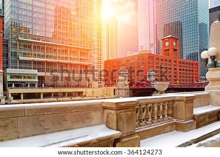 Chicago downtown riverfront, office buildings and river at sunset - stock photo