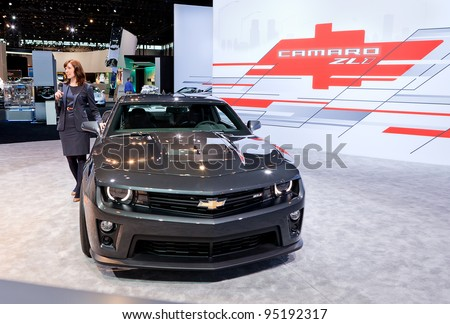 CHICAGO - FEB 9: A reporter talking about the new Chevy Camaro ZL0 at the 2012 Chicago Auto Show Media Preview on February 9, 2012 in Chicago, Illinois. - stock photo