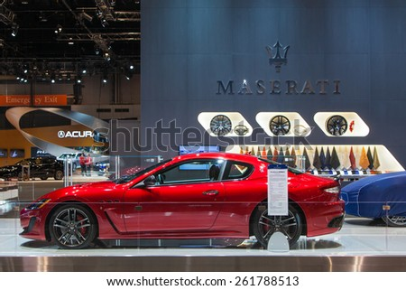Chicago - February 12: A Maserati Granturismo sits under cover February 12th, 2015 at the 2015 Chicago Auto Show in Chicago, Illinois. - stock photo