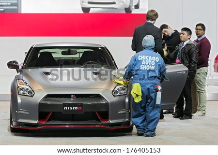 CHICAGO - FEBRUARY 7 : A 2014 Nissan Nismo GTR being prepped for the Chicago Auto Show media preview February 7, 2014 in Chicago, Illinois. - stock photo