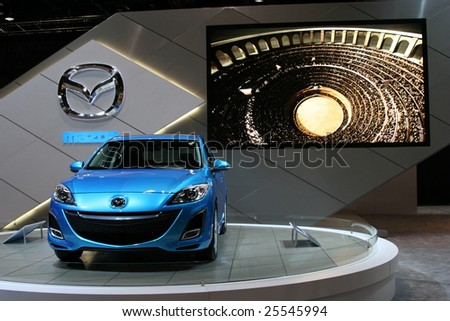 CHICAGO, FEBRUARY 18, 2009:  All Mazda3 models have an athletic look, and the engine lineup continues to be the MZR 2.0-liter.  Displayed at the Auto Show 2009 in Chicago. - stock photo