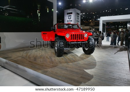 CHICAGO - FEBRUARY 13: Jeep 4x4 new vehicle presentation at the Annual Chicago Auto Show February 13, 2010 in Chicago, IL. - stock photo