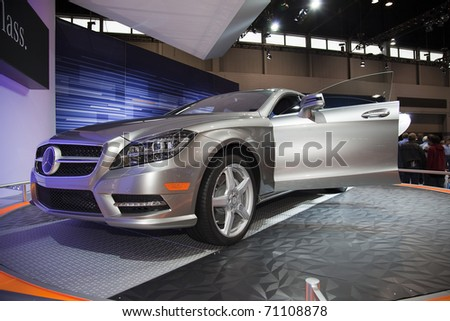 CHICAGO - FEBRUARY 12: Mercedes CLS presentation at the Annual Chicago Auto Show February 12 2011 in Chicago, IL. - stock photo