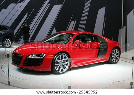 CHICAGO, FEBRUARY 18, 2009: The 2009 AUDI R8 is Incorporating the name and the genes of the five-time Le Mans winner; the first production Audi mid-engine sports car. Displayed at the Auto Show 2009 in Chicago. - stock photo