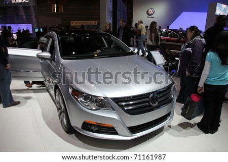 CHICAGO - FEBRUARY 12: The Volkswagen CC presentation at the Annual Chicago Auto Show on February 12, 2011 in Chicago, IL. - stock photo