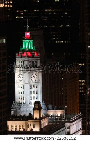 Chicago, IL - December 28:  The Wrigley Building in downtown Chicago on December 28, 2008 displays festive colored holiday lights on the clock tower in celebration of the holiday season. - stock photo