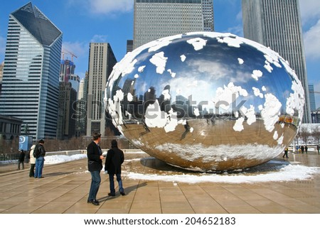 CHICAGO, IL-FEB 09: Unidentified people visit Skygate Bean covering by snow with skyline reflection of high building towers at Millennium Park on February 09, 2008 in Chicago, IL USA. - stock photo